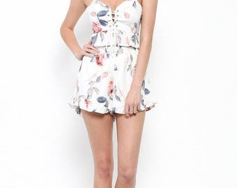 A floral print lace up top and ruffle shorts set