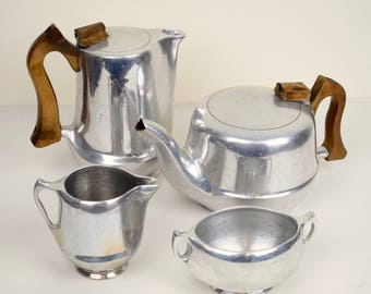 Classic mid Century retro Picquotware set; tea pot, coffee pot, sugar bowl and creamer