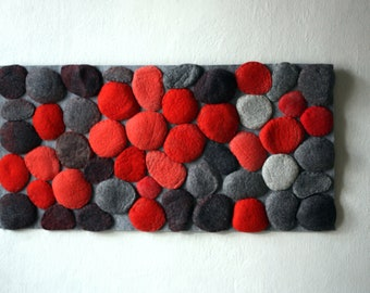 Felted rug with red and grey felt stones