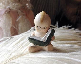 Vintage mini kewpie figurine tiny chalkware doll reading book miniature plaster kewpie baby blue wings