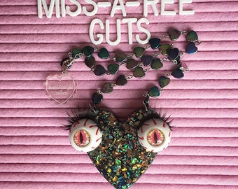 Frend Necklace; black resin with iridescent flakes big eyes and lashes statement piece festival fun