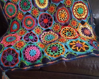 Kaleidoscope Blanket. Proceeds go to charity.