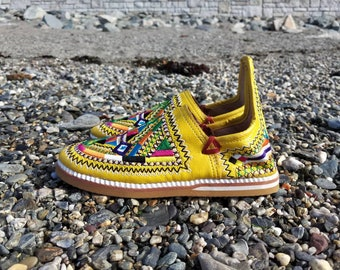 Handmade yellow embroidered shoes