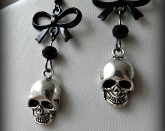 Gothic human skull dangle earrings.