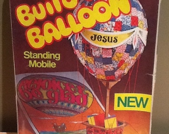 "Vintage 1981 Build-A-Balloon Standing Mobile kit. ""Pak contains materials for three pupils"". Unopened vintage new stock. The kit contains:"