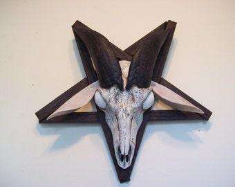 goat skull casting in a pentagram