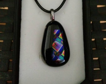 Black and dichroic glass pendant.
