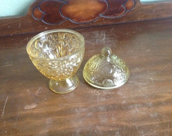Yellow Avon candy dish and lid