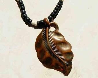 Vintage Copper or Brass Metal Leaf Pendant Centerpiece On Wooden Bead Necklace