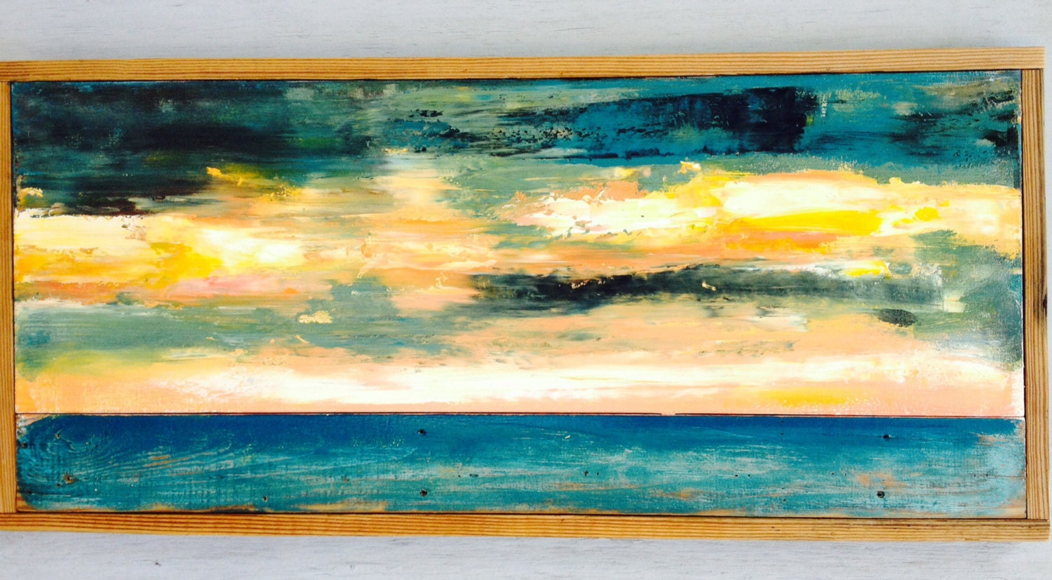 Abstract painting on canvas and distressed wood