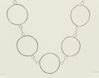 Sterling silver necklace with large, textured, organic circles