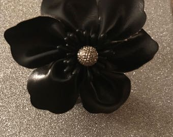 Beautiful black leather floral sccent bracelet on a gold metallic leather bracelet.