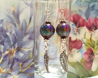 Mood bead earrings with silver leaf dangle.