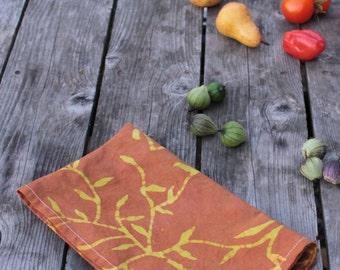 cotton tea towel rust and chartreuse vines batik