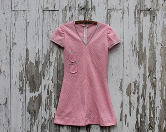 Bubblegum pink v-neck short sleeved minidress, two small pockets, blue floral ribbon detail, medium, zipper back, 1960s dress