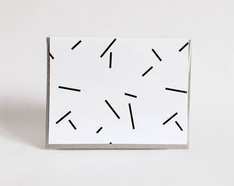 greeting card: geometric black and white card, lines, sticks, fireworks