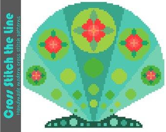 Cross stitch pattern of a beautiful Boho seashell. Modern embroidery chart. Contemporary folk design.