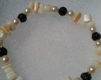 black, white and tan bracelet