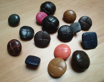 lot of different faux leather plastic buttons