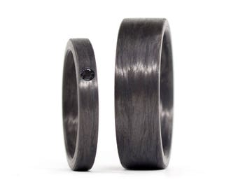Set of two black carbon fiber wedding and engagement bands. Unique jewelry flat rings. Engagement Rings (00101_4Sn7N)