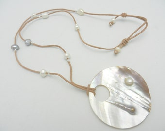 Long natural leather and pearl necklace