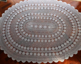 Vintage oval white crocheted tablecloth in excellent condition.  Proceeds to charity VACD Ltd