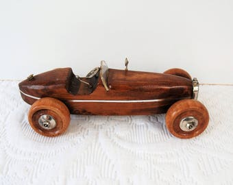 Wooden and silver toy car.