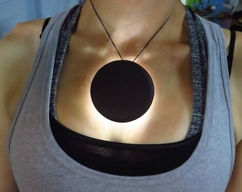 "LED Solar Eclipse Pendant - 2 3/4"" diameter light-up necklace"