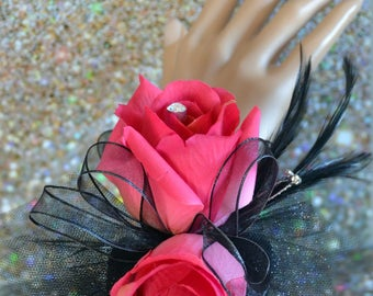 Deep pink and black wrist corsage and boutonniere set