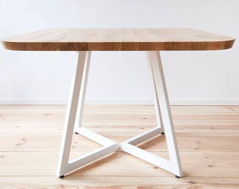 Solid oak square dining table on steel base