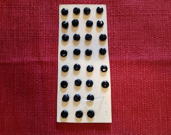 Small antique black glass sequin-buttons