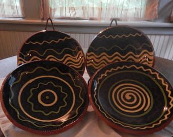 Four 7-inch Diameter Nolde Forest Pottery Redware Plates