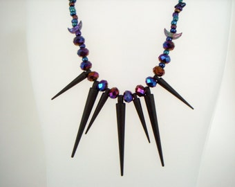 Celestial Moon Spikes Night Sky Necklace black spikes with iridescent blue crescent moon beads