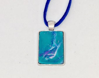 "Aqua and Periwinkle - 3/4 x 1"" Original Acrylic Art Captured under Glass Bezel within Pendant with coordinating colbalt  cord."