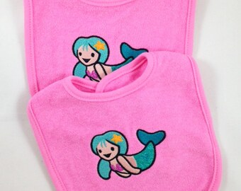 Sweet little set of mermaid bibs stitched your way!