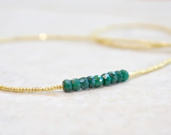 emerald beaded necklace with true cut seed beads. green emerald necklace. emeralds and gold seed beaded necklace. green with gold necklace
