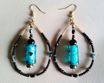 AQUA HOOP EARRINGS with Aquamarine Silverfoil Bead and Black, Gold, Bronze, Iridescent Seed Beads. Teal Drop Shaped Hoop Dangle Earrings