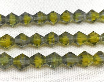 12 Vintage Olive Green Givre German Bicone Glass Beads