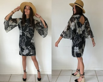 Vintage 1960s Black Tropical Floral Print Mini Shift Dress with Bell Sleeves and Peekaboo Back - Resort wear/ Hawaii