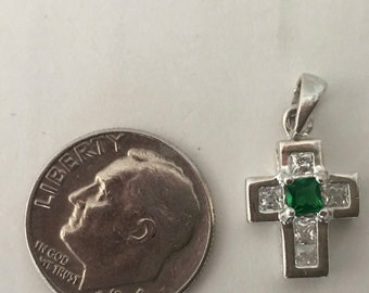 Sterling Silver cross with emerald green crystal center and attached bail