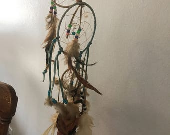 Vintage hand laced dream catchers. Linked together.