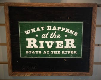 What Happens at the River Stays at the River Sign on Reclaimed Wood