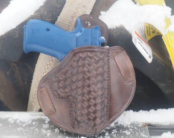 Custom hand tooled leather pancake holster for a CZ 75 compact.