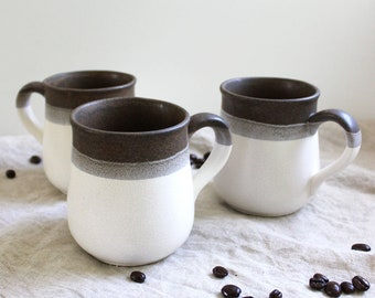 Set of three vintage 1970s stoneware mugs. Made in Japan.