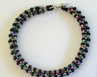 Purple Glass Pearls and Seed beads Bangle Bracelet by Carol Wilson of Je t'adorn
