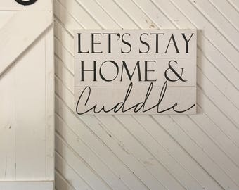 lets stay home and cuddle wood sign