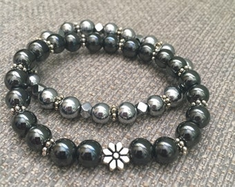 Black & Silver ,Hematite ,Stackable, Stretch ,Bracelets with Silver Plated Flower Accent. #blackbracelet
