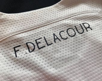Iron on F. Delacour name label design