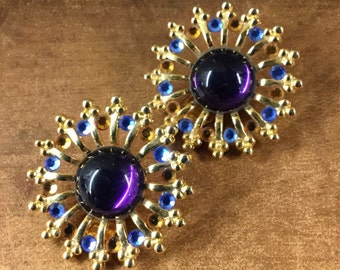 Quite Large Starburst Sunburst Rhinestone and Glass Cabochon Earrings Clip On Unsigned Purple Cabochon Blue and Gold Faceted Rhienstones