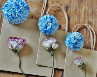 Set of three gift bags with blue pom poms  Gift bags Blue pom poms